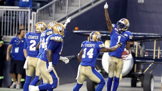 Winnipeg Blue Bombers' Darvin Adams (1) celebrates his touchdown catch against the Edmonton Eskimos during the first half in Winnipeg on Thursday.