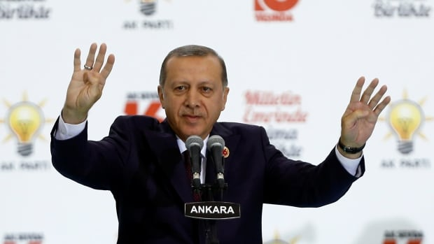 Turkish President Tayyip Erdogan greets the audience during a ceremony to mark the 16th anniversary of his ruling AK Party's foundation in Ankara on Aug. 14. Erdogan has been lashing out at countries in Europe as he has consolidated power.