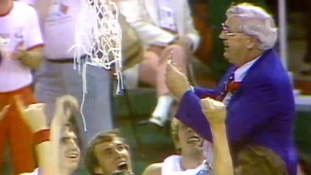 Canadian men's basketball coach, Jack Donohue, right, is lifted up by his players to cut down the net after their defeat of Yugoslavia gave the country its first and only Universiade gold medal in the sport.