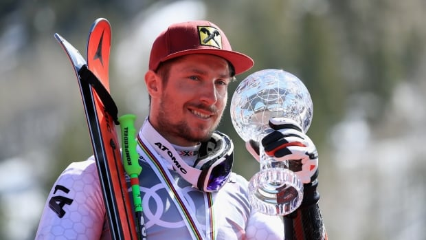 Marcel Hirscher of Austria celebrates with his globe for winning the season title for the men's giant slalom during the 2017 World Cup.