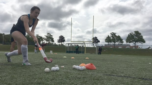 A university student participates in a drill exercise at a field hockey players clinic at the University of P.E.I. Friday morning.