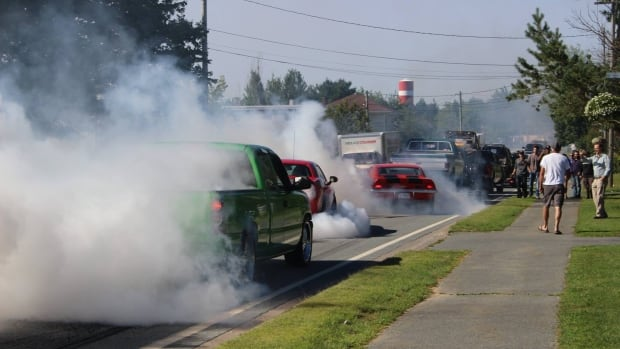 "Burnouts in a funeral procession for Christopher ""Kipper"" McCulloch on Highway 2 in Enfield, N.S., on Aug. 17, 2017."