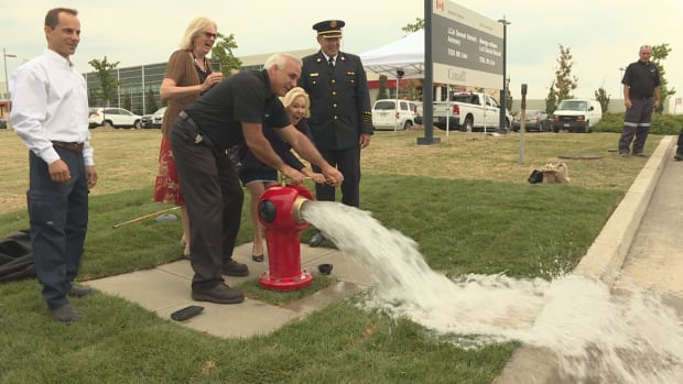 Mississauga Mayor Bonnie Crombie opens the city's new Spartan hydrant with the hydrant's inventor, retired firefighter George Sigelakis on Thursday.