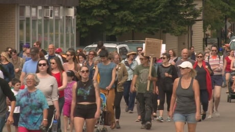 Protesters against white supremacy march in downtown Charlottetown thumbnail