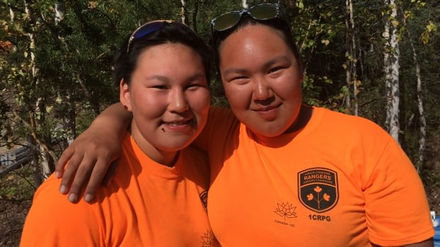Junior Canadian Rangers Sharion Poodlat and Jenell Ogruk  from Taloyoak, Nunavut pose for a photo during the training exercise in the Yellowknife area.