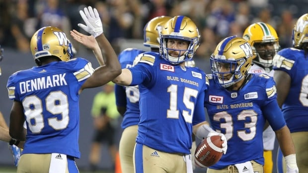 Winnipeg Blue Bombers WR Clarence Denmark, QB Matt Nichols and RB Andrew Harris celebrate victory after CFL action between the Bombers and the Edmonton Eskimos in Winnipeg on Thursday.