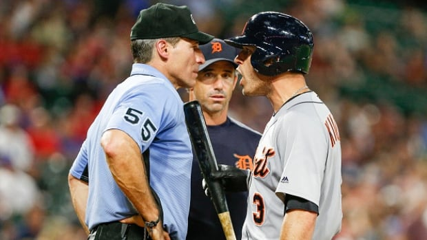 Detroit Tigers second baseman Ian Kinsler, right, was fined but not suspended for a verbal tirade against umpire Angel Hernandez.