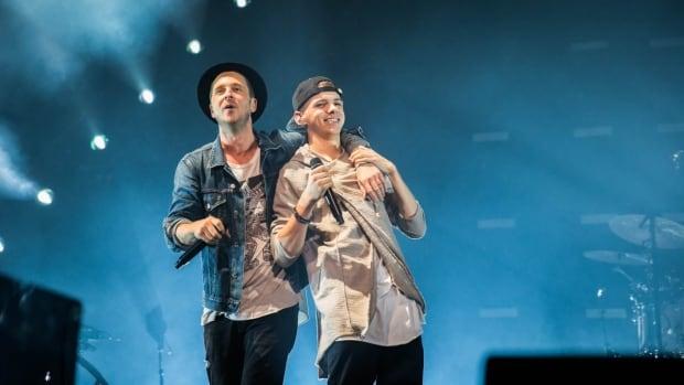 OneRepublic frontman Ryan Tedder (left) with 17-year-old Brendan Prince. Prince sang 'I Lived' with OneRepublic in Edmonton on Friday.