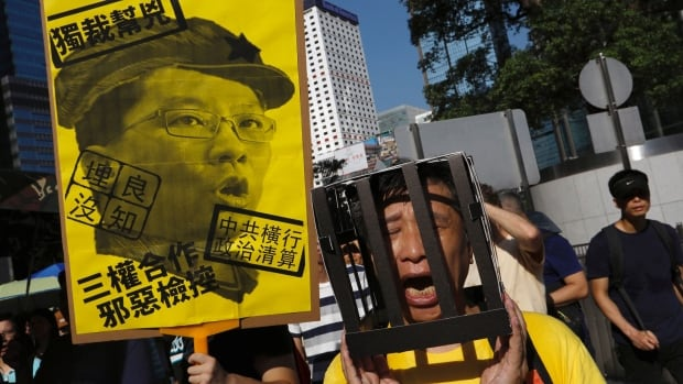 Thousands of demonstrators took to the streets of Hong Kong on Sunday to protest against the jailing of student leaders Joshua Wong, Nathan Law and Alex Chow. They were imprisoned for taking part in the 2014 pro-democracy Umbrella Revolution, also known as the 'Occupy Central' protests.