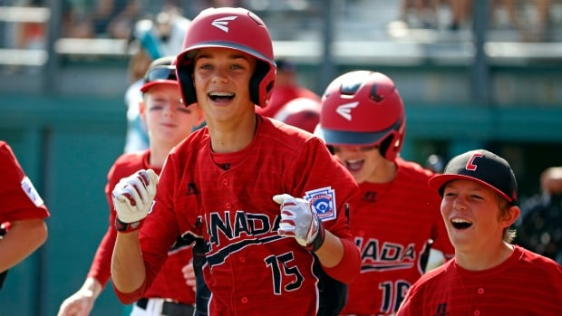 Canada's Reid Hefflick (15) celebrates with teammates as he returns to the dugout after hitting a three-run home run in the first inning of their International pool play game at the Little League World Series in South Williamsport, Pa., on Sunday.