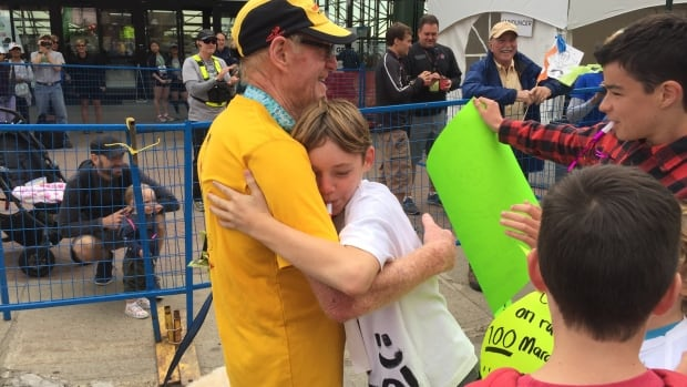 Marathon runner Roger Macmillan was greeted with hugs at the Edmonton Marathon on Sunday. The marathon was his 100th race.