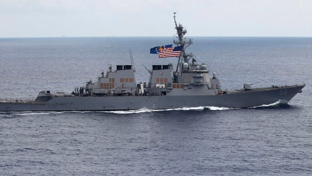 The USS John S. McCain destroyer sails is seen in August 2011.