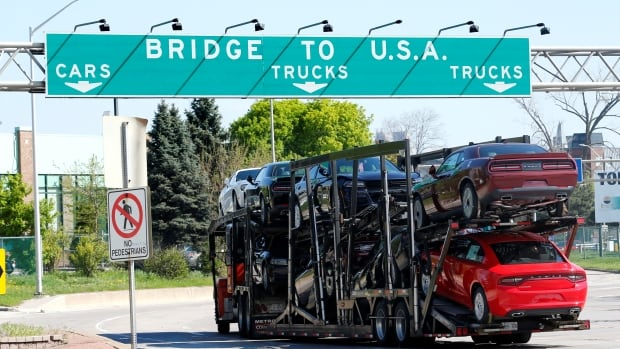A car hauler bound for Detroit, Mich., drives heads for the Ambassador Bridge in Windsor, Ont., in this April 2017 photo.