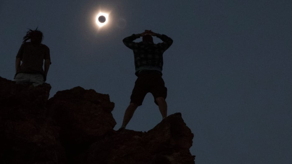 Enthusiasts watch a total solar eclipse while standing atop Carroll Rim Trail near Mitchell, Oregon, U.S. August 21, 2017.