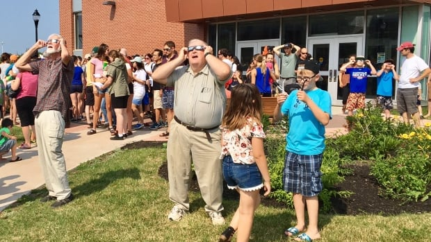 Special viewing glasses allowed spectators to gaze into the eclipse without fear of eye damage.