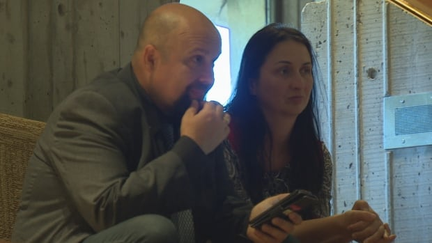 Eldin Husic and his wife watch the council meeting on Aug. 21, knowing the fate of their restaurant could be decided.