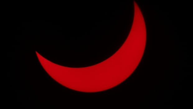 The partial eclipse drew crowds from across Hamilton to witness the natural phenomenon.