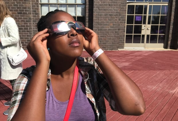 Woman viewing the eclipse in Regina