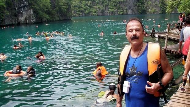 John Abou-Samra enjoying Kayangan Lake, Philippines, moments before his leg went through the pier underfoot.