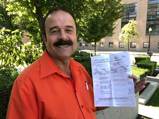 John Abou-Samra with medical donation receipt