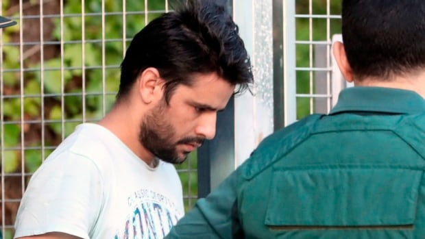 Mohamed Aallaa, 27, one of four arrested in relation to the terrorist attacks in Catalonia, is taken to the Audiencia Nacional court in Madrid. The judge later ordered Aallaa's release from custody.