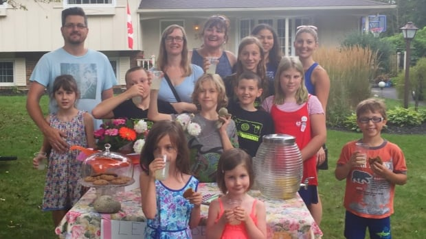 Neighbours and friends joined the Bowen family at their lemonade stand in London, ON. The fundraiser was organized by the family for Carly White of Carmanville, NL, who suffered a stroke earlier this month.