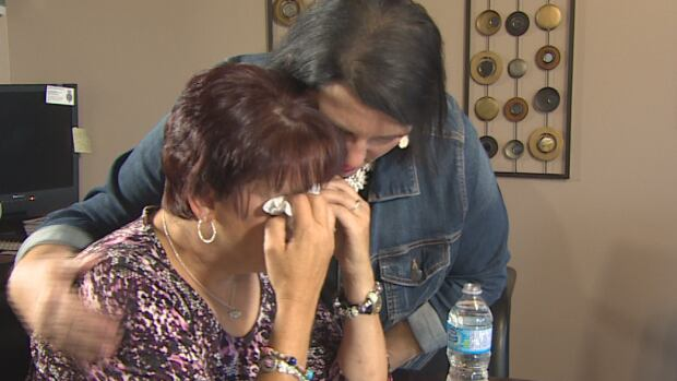 Lisa Lake, Cortney Lake's mother, is comforted by her sister Glenda Power.