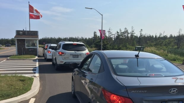 Cars were lined up Tuesday afternoon for their free park passes at the Brackley Beach entrance to P.E.I. National Park.