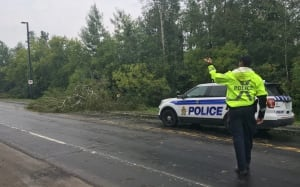 Ottawa police tree down Airport Parkway thunderstorm directing traffic Aug 22 2017
