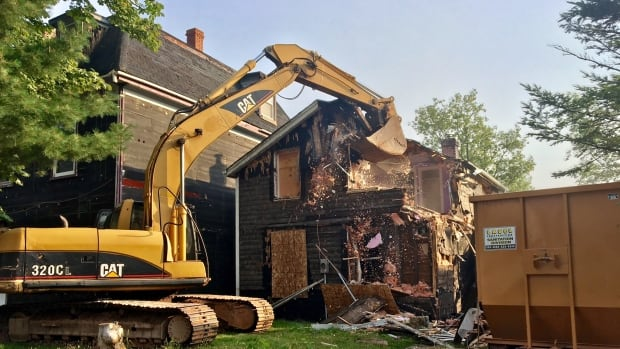 Heavy equipment has been brought in for the demolition.