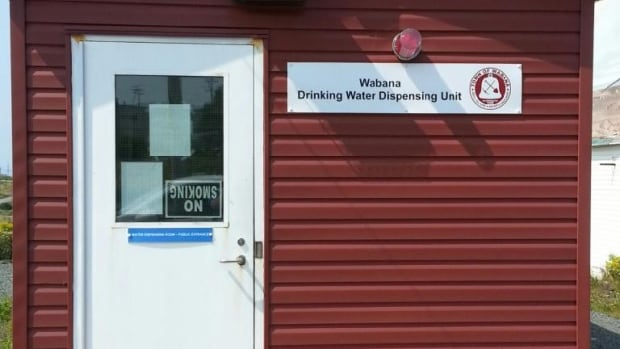 The drinking water dispensing unit in Wabana, N.L., is inside this building. A business owner now says he inadvertently purchased the system from the town, and plans to charge rent of $3,000 a month.