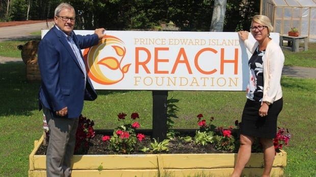 Cardigan MP Lawrence MacAulay poses with Reach Foundation co-founder Cheryl Roche at the Stratford facility.