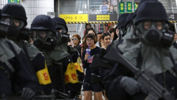 Passengers watch South Korean police officers carry out an anti-terror drill as a part of Ulchi Freedom Guardian exercise at a subway station in Seoul South Korea Tuesday. The same day MPs on a parliamentary committee in Ottawa pondered how to address