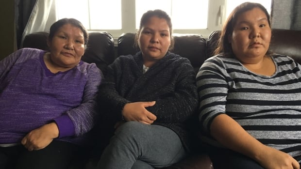April Pone, right, with her sister Monique (middle), and mother Josie (left). Pone says her daughter was sick for four days before she called an ambulance