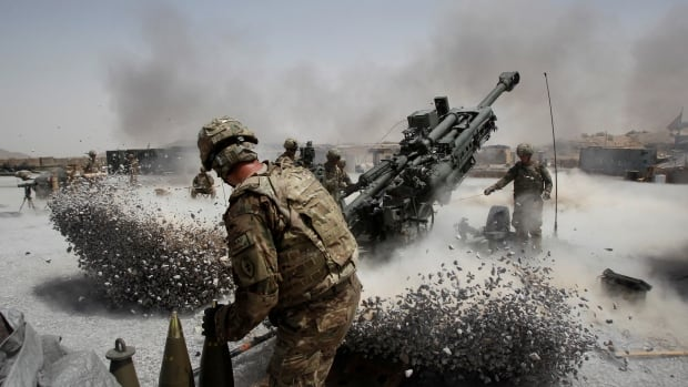 No this isn't a video game. Soldiers fire a howitzer in Kandahar in 2011. President Donald Trump says the U.S. will continue to spend tax dollars in Afghanistan.