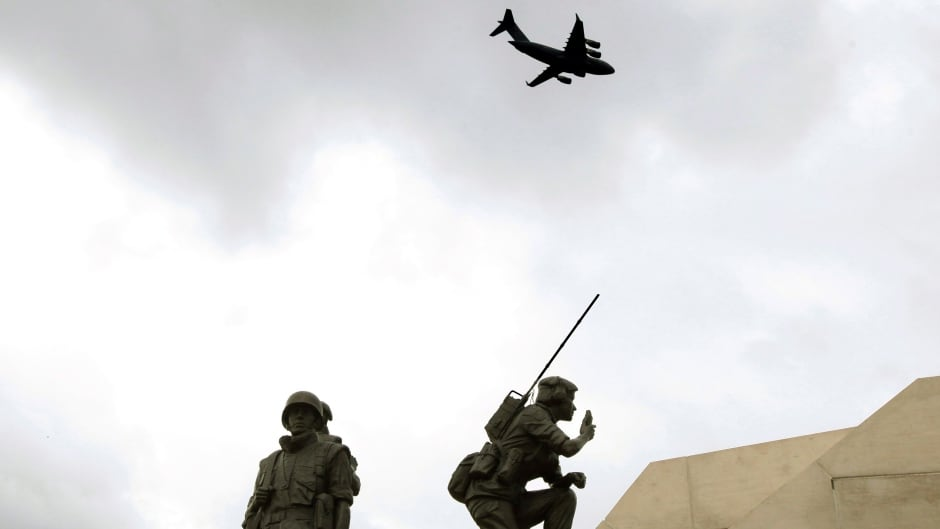 A Royal Canadian Air Force C-17 makes a fly past over the Peacekeeping Monument in Ottawa during a 2012 ceremony honouring fallen peacekeepers.