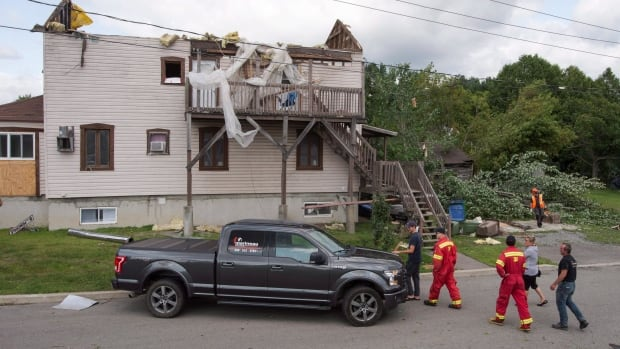 The tornado tore through town, taking off the roof of one home.