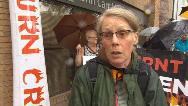 Lauren Davenport was among the demonstrators who turned up at South Centre MP Jim Carr's constituency office on Wednesday. She retired 14 months ago but says she still hasn't received her severance pay.