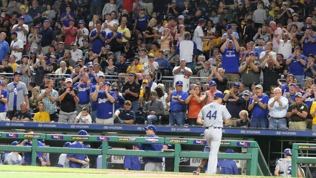 Los Angeles Dodgers starting pitcher Rich Hill lost his no-hit bid in the 10th inning after Pittsburgh Pirate Josh Harrison hit a walk-off home run.