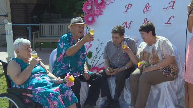 Maria and Lorenzo Bordignon and Phyllis and Anthony Grippo raise a toast during the garden ceremony in Burnaby.