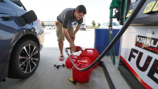 Chris Mathew fills his vehicle and five gas cans in preparation for tropical storm Harvey in Pearland, Texas. The U.S. National Hurricane Center said Harvey would reach the Texas coast at hurricane strength on Friday.