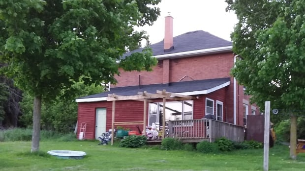 Home owned by the Grand River Conservation Authority occupied by Mary-Timothy Hare and family.