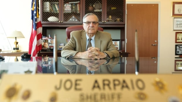 Joe Arpaio, the sheriff of Maricopa County in Arizona from 1993 to 2016, presides over his office in Phoenix in October 2016. While Arpaio awaits sentencing for defying court orders, U.S. President Donald Trump is musing about pardoning him.​ (Jason Burles/CBC)