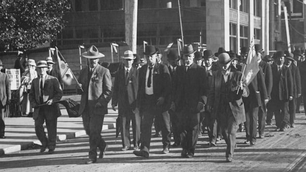Oliver, second-from-right in front, leads a march through Edmonton in this undated photo.