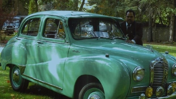 A snapshot of Sri Ramalingam and the restored Austin A40 Somerset - the exact same make of car his parents drove when he was young in Sri Lanka.