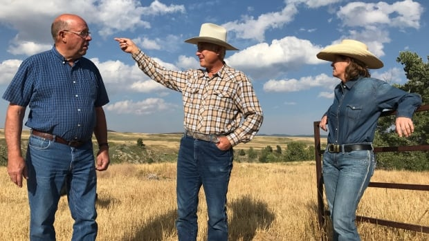 From left, Ted Smith, Raymond Nadeau, Shawna Burton on Smith's ranch near Maycroft, Alta.