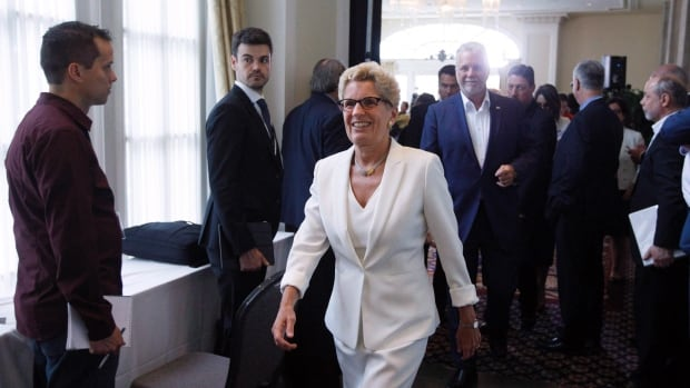 Ontario Premier Kathleen Wynne makes her way to the the Council of Federation meetings in Edmonton Alta, on Tuesday, July 18. The last nine of months of government-commissioned polling, obtained by The Canadian Press through a Freedom of Information request, suggest improving public opinion fortunes for a now somewhat less unpopular Liberal government.