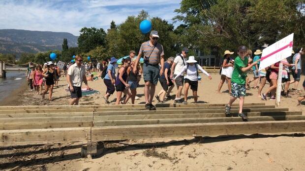 Kelowna walk the beach Okanagan Lake foreshore protest