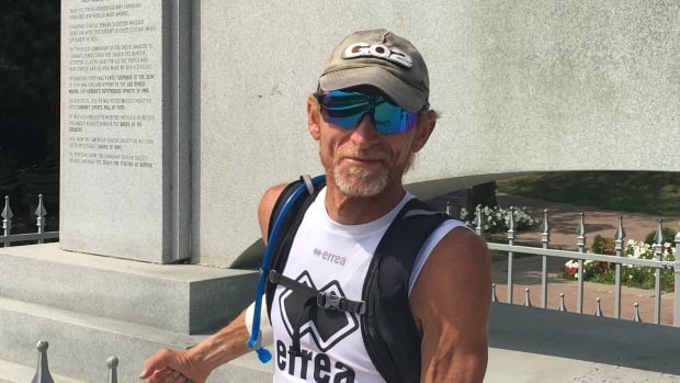 French athlete and cancer survivor Guy Amalfitano arrived Friday at the monument to his hero, Terry Fox, during a cross-Canada run in his honour.