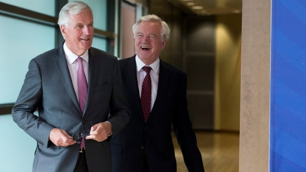 European Union chief Brexit negotiator Michel Barnier, left, speaks with British Secretary of State David Davis prior to a meeting at EU headquarters in Brussels on Monday. The EU and Britain started a third round of Brexit negotiations on Monday.